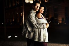 Attractive young couple at night. Young couple at night on the city Royalty Free Stock Images