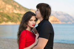 Attractive young couple portrait, romantic lovers in love at bea Royalty Free Stock Photo