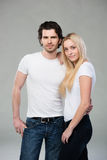 Attractive young couple posing for the camera Stock Images