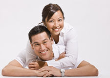 Attractive Young Couple Posing on Floor Royalty Free Stock Image