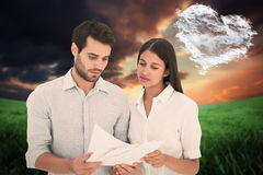 Attractive young couple reading their bills Stock Photo