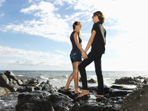 Attractive Young Couple on Rocks Stock Photography