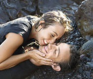 Attractive Young Couple on Rocks Smiling Stock Image