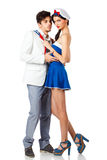 Attractive young couple roleplay in sailor uniform. Attractive young couple enjoy roleplay in sailor uniform and elegant suit. Isolated on white background. High Royalty Free Stock Image