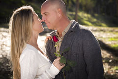 Attractive Young Couple with Rose Stock Image