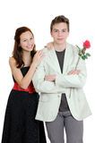 Attractive young couple with rose in hands isolated on the white background Stock Photo