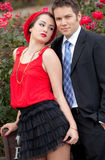 Attractive Young Couple By Roses Royalty Free Stock Photo