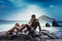 Attractive young couple by the sea