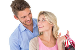 Attractive young couple with shopping bags Royalty Free Stock Photography