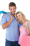 Attractive young couple with shopping bags and credit card Stock Photo
