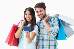 Attractive young couple with shopping bags and credit card Stock Images
