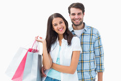 Attractive young couple with shopping bags Stock Photo