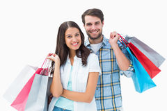 Attractive young couple with shopping bags Stock Photos