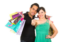 Attractive young couple shopping with credit card Royalty Free Stock Photos