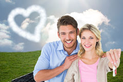 Attractive young couple showing new house key Stock Photo