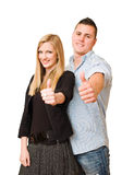 Attractive young couple showing thumbs up. Stock Photos