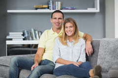 Attractive young couple sitting on their couch Stock Image
