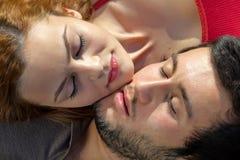 Attractive young couple sleeping Stock Photos