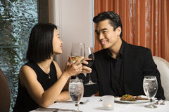Attractive Young Couple Smiling at Each Other Stock Photos