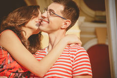 Attractive young couple smiling and kissing. Close up of happy couple in red clothes stock photo
