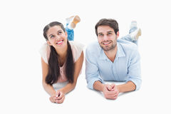 Attractive young couple smiling looking up Royalty Free Stock Images