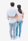 Attractive young couple standing with arms around Royalty Free Stock Images