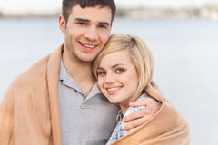Attractive young couple standing on beach at summer. Stock Images