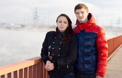 Attractive young couple standing on a promenade Royalty Free Stock Photos
