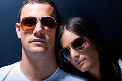 Attractive young couple with sunglasses Royalty Free Stock Photography