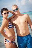 Attractive young couple in swimwear and sunglasses Stock Image