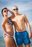 Attractive young couple in swimwear and sunglasses Stock Photos