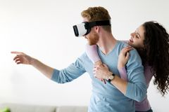 Attractive young couple trying virtual reality headset stock photography