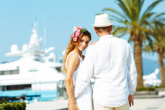 Attractive young couple walking alongside the marina in summer s Royalty Free Stock Images