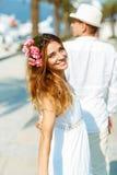 Attractive young couple walking alongside the marina - wedding c Stock Photography