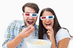 Attractive young couple watching a 3d movie Royalty Free Stock Image