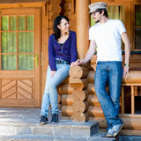 Attractive young couple at wooden house Royalty Free Stock Photo