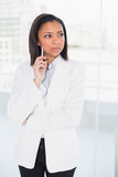 Attractive young dark haired businesswoman posing looking away Royalty Free Stock Image