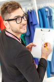 Attractive young designer making sketches in workshop Royalty Free Stock Photo