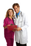 Attractive young doctor and nurse with good news Royalty Free Stock Images