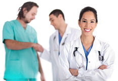 Attractive young doctor smiling, other doctor Royalty Free Stock Images