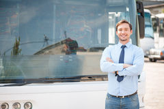 Attractive young driver is having rest outside Royalty Free Stock Images