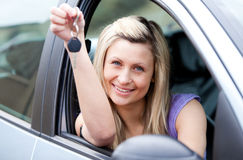 Attractive young driver holding a key Royalty Free Stock Images