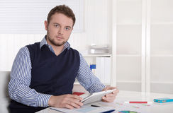 Attractive young entrepreneur working with digital tablet. Stock Images