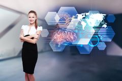 Artificial intellect and innovation concept. Attractive young european businesswoman standing on blurry interior background with abstract brain hologram royalty free stock photography