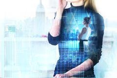 Finance and copyspace concept. Attractive young european women talking on the phone on abstract city background with financial diagram. Finance and copyspace Royalty Free Stock Photos