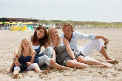 Attractive young family. By the seaside enjoying the summer Royalty Free Stock Images