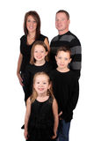 Attractive young family. Young family portrait with parents, two girls and one boy on a white background royalty free stock photos