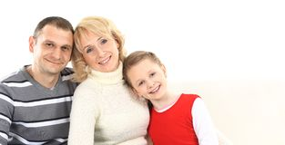 Attractive young family with a child Royalty Free Stock Photos