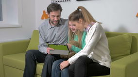 Attractive young family using a tablet to make future plans stock footage