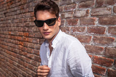 Attractive young fashion man looking at the camera Stock Photos